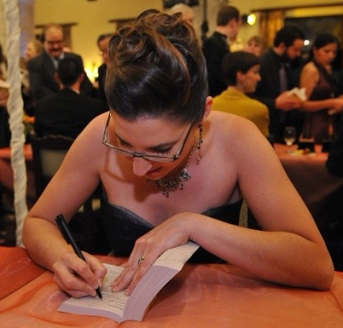 Corry signing books at the Writers of the Future award ceremony